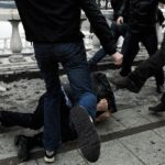 Избиение группой лиц